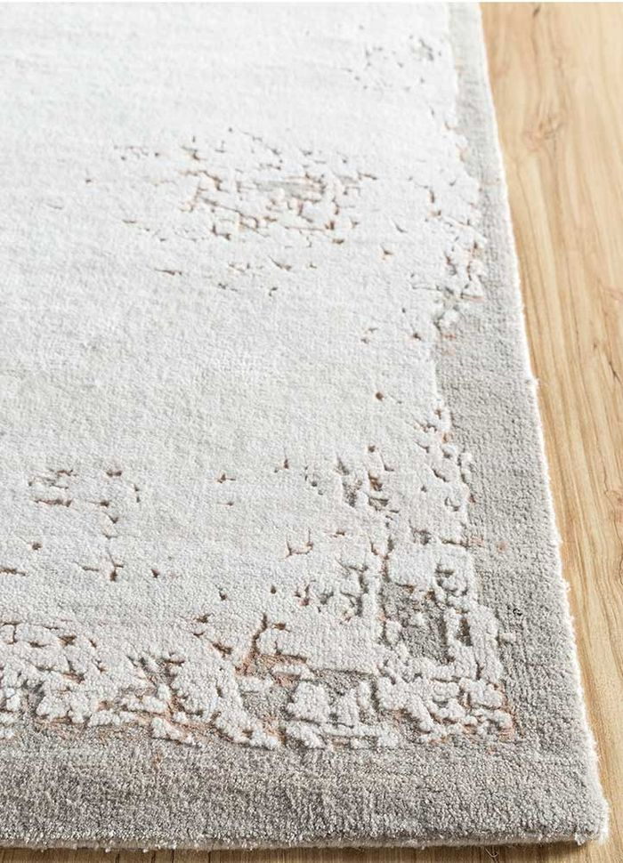 urban pause by kavi ivory wool and bamboo silk hand knotted Rug - Corner