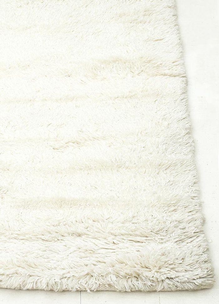 aprezo ivory wool and viscose shag Rug - Corner